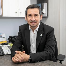 DR. ENRIQUE RIQUELME MELLA